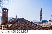 Купить «Bosnia: roofs and skyline of Mostar, old city named after the bridge keepers (mostari) who in the medieval times guarded the Stari Most (Old Bridge)», фото № 30368935, снято 24 февраля 2018 г. (c) Николай Коржов / Фотобанк Лори