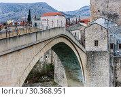 View of Stari Most a 16th-century Ottoman bridge over Neretva river in the city of Mostar in Bosnia Herzegovina (2018 год). Редакционное фото, фотограф Николай Коржов / Фотобанк Лори