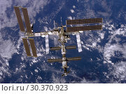 Купить «EARTH -- 19 Dec 2006 -- Backdropped by a blue and white Earth, the International Space Station moves away from Space Shuttle Discovery. Earlier the STS...», фото № 30370923, снято 22 мая 2019 г. (c) age Fotostock / Фотобанк Лори