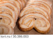 Купить «fried Palmier laid out on counter», фото № 30386003, снято 30 января 2018 г. (c) Татьяна Яцевич / Фотобанк Лори