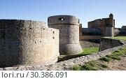 Купить «Stone towers and walls of imposing medieval fortified Chateau de Salses, French Catalonia», видеоролик № 30386091, снято 29 января 2019 г. (c) Яков Филимонов / Фотобанк Лори