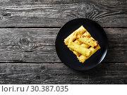Купить «tasty crepes rolls with cream cheese filling», фото № 30387035, снято 6 марта 2019 г. (c) Oksana Zh / Фотобанк Лори