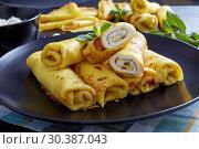 Купить «crepes roll up filled with sweet white cheese», фото № 30387043, снято 6 марта 2019 г. (c) Oksana Zh / Фотобанк Лори