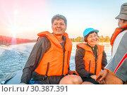 Купить «Mature men and women in life jackets go on an inflatable boat on a beautiful river.», фото № 30387391, снято 15 июля 2017 г. (c) Акиньшин Владимир / Фотобанк Лори