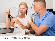 Купить «Dermatologist is consulting to female patient about her skin of face», фото № 30387839, снято 7 августа 2017 г. (c) Яков Филимонов / Фотобанк Лори