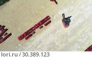 Купить «Forklift transports disc harrow. Transportation equipment», видеоролик № 30389123, снято 4 июля 2018 г. (c) Андрей Радченко / Фотобанк Лори