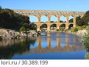 Купить «Pont du Gard, an ancient Roman aqueduct in France», фото № 30389199, снято 26 июня 2018 г. (c) Anton Eine / Фотобанк Лори