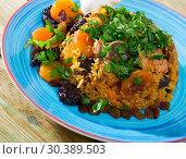 Купить «Pilaf from mutton with dried apricots, prunes», фото № 30389503, снято 20 апреля 2019 г. (c) Яков Филимонов / Фотобанк Лори