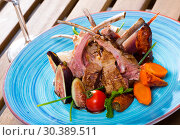 Купить «BBQ mutton ribs served with fresh figs», фото № 30389511, снято 19 апреля 2019 г. (c) Яков Филимонов / Фотобанк Лори