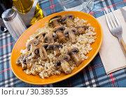Купить «Barley porridge with roasted mushrooms», фото № 30389535, снято 27 июня 2019 г. (c) Яков Филимонов / Фотобанк Лори