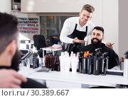 Купить «male hairdresser showing resulting haircut to client at hair salon», фото № 30389667, снято 27 января 2017 г. (c) Яков Филимонов / Фотобанк Лори