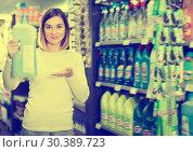 Купить «Young female shopper searching for cleaners», фото № 30389723, снято 23 ноября 2016 г. (c) Яков Филимонов / Фотобанк Лори