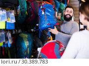 Couple choosing rucksack in store. Стоковое фото, фотограф Яков Филимонов / Фотобанк Лори