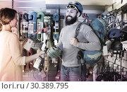 Купить «Smiling climbers examining alpinism equipment items», фото № 30389795, снято 24 февраля 2017 г. (c) Яков Филимонов / Фотобанк Лори