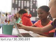 Купить «Side view of mixte ethnicity school girls using laptop in classroom at school», фото № 30390691, снято 17 ноября 2018 г. (c) Wavebreak Media / Фотобанк Лори