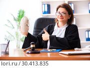 Купить «Middle-aged female doctor working in courthouse», фото № 30413835, снято 4 декабря 2018 г. (c) Elnur / Фотобанк Лори
