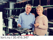 Купить «Husband and wife in home appliance shop to discuss item», фото № 30416347, снято 21 ноября 2019 г. (c) Яков Филимонов / Фотобанк Лори