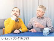 Купить «Mature father and son serious talk», фото № 30416399, снято 18 июня 2019 г. (c) Яков Филимонов / Фотобанк Лори