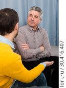 Купить «Adult father and son solve problems», фото № 30416407, снято 18 июня 2019 г. (c) Яков Филимонов / Фотобанк Лори