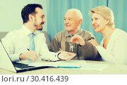 Купить «Old man and woman sign rent agreement», фото № 30416439, снято 20 ноября 2019 г. (c) Яков Филимонов / Фотобанк Лори