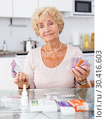 Купить «Woman among a lot of medicines», фото № 30416603, снято 11 июля 2018 г. (c) Яков Филимонов / Фотобанк Лори