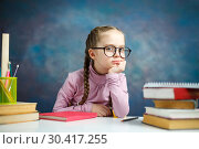 Купить «Little Thoughtful Caucasian Student Girl Study», фото № 30417255, снято 9 февраля 2019 г. (c) Иван Карпов / Фотобанк Лори