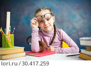 Купить «Pretty Caucasian Primary School Girl Portrait», фото № 30417259, снято 9 февраля 2019 г. (c) Иван Карпов / Фотобанк Лори
