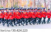 Купить «Russia Samara November 2018: the cadet corps of Mordovia EMERCOM of Russia marches through the square. Text in Russian: Cadets of Mordovia.», фото № 30424223, снято 7 ноября 2018 г. (c) Акиньшин Владимир / Фотобанк Лори