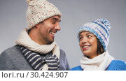 Купить «happy couple in winter wear looking at each other», видеоролик № 30424907, снято 24 марта 2019 г. (c) Syda Productions / Фотобанк Лори