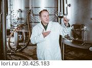 Купить «Mature male with glass of wine», фото № 30425183, снято 12 октября 2016 г. (c) Яков Филимонов / Фотобанк Лори