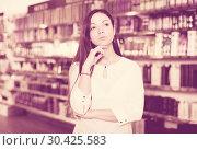 Unhappy young female customer standing in cosmetics studio. Стоковое фото, фотограф Яков Филимонов / Фотобанк Лори