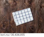 Купить «linen napkin on wooden table, top view, mock up», фото № 30434055, снято 13 февраля 2019 г. (c) Ольга Сергеева / Фотобанк Лори