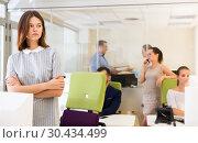 Купить «unhappy girl in modern open plan office», фото № 30434499, снято 1 августа 2018 г. (c) Яков Филимонов / Фотобанк Лори