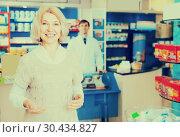 Female customer in pharmacy drugstore. Стоковое фото, фотограф Яков Филимонов / Фотобанк Лори