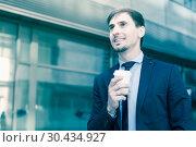 Купить «Portrait of cheerful male standing outdoor», фото № 30434927, снято 29 апреля 2017 г. (c) Яков Филимонов / Фотобанк Лори