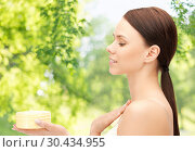 Купить «beautiful woman with moisturizing cream», фото № 30434955, снято 2 апреля 2011 г. (c) Syda Productions / Фотобанк Лори
