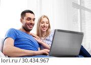 Купить «happy couple with laptop computer at home», фото № 30434967, снято 9 февраля 2014 г. (c) Syda Productions / Фотобанк Лори