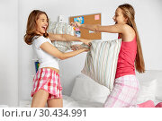 Купить «happy teen girl friends fighting pillows at home», фото № 30434991, снято 14 ноября 2015 г. (c) Syda Productions / Фотобанк Лори