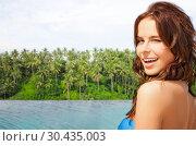 Купить «happy woman over infinity edge pool in sri lanka», фото № 30435003, снято 21 июля 2012 г. (c) Syda Productions / Фотобанк Лори