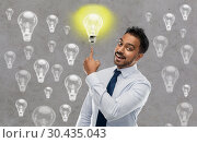 Купить «indian businessman pointing finger at light bulb», фото № 30435043, снято 12 января 2019 г. (c) Syda Productions / Фотобанк Лори