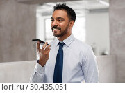 Купить «businessman using voice command on smartphone», фото № 30435051, снято 12 января 2019 г. (c) Syda Productions / Фотобанк Лори