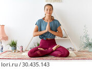 Купить «woman meditating in lotus pose at yoga studio», фото № 30435143, снято 21 июня 2018 г. (c) Syda Productions / Фотобанк Лори
