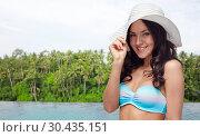 Купить «happy woman over infinity edge pool in sri lanka», фото № 30435151, снято 14 апреля 2015 г. (c) Syda Productions / Фотобанк Лори