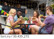 Купить «happy friends with drinks eating at food truck», фото № 30435215, снято 1 августа 2017 г. (c) Syda Productions / Фотобанк Лори
