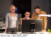 Купить «business team with computer working late at office», фото № 30435267, снято 26 ноября 2017 г. (c) Syda Productions / Фотобанк Лори