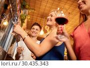 Купить «happy women pouring wine from dispenser at bar», фото № 30435343, снято 25 июня 2018 г. (c) Syda Productions / Фотобанк Лори
