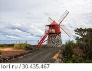 Купить «Windmill on shores of the Atlantic Ocean, Pico Island, Azores», фото № 30435467, снято 3 мая 2012 г. (c) Юлия Бабкина / Фотобанк Лори