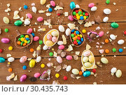 Купить «chocolate eggs and candy drops on wooden table», фото № 30435743, снято 15 марта 2018 г. (c) Syda Productions / Фотобанк Лори
