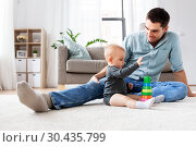 Купить «father playing with little baby daughter at home», фото № 30435799, снято 25 августа 2018 г. (c) Syda Productions / Фотобанк Лори