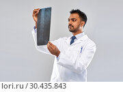 Купить «indian doctor looking at spine x-ray», фото № 30435843, снято 12 января 2019 г. (c) Syda Productions / Фотобанк Лори
